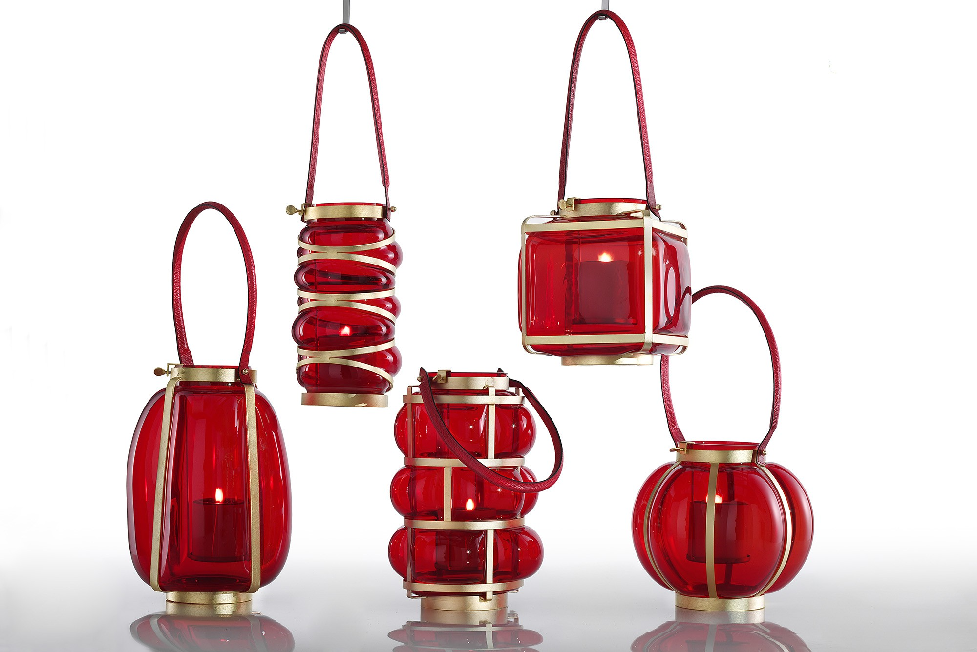 Square red glass and gold lantern, leather handle