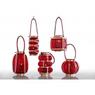 Round red glass and gold lantern, leather handle